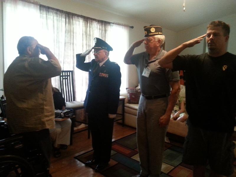 Four Men Saluting
