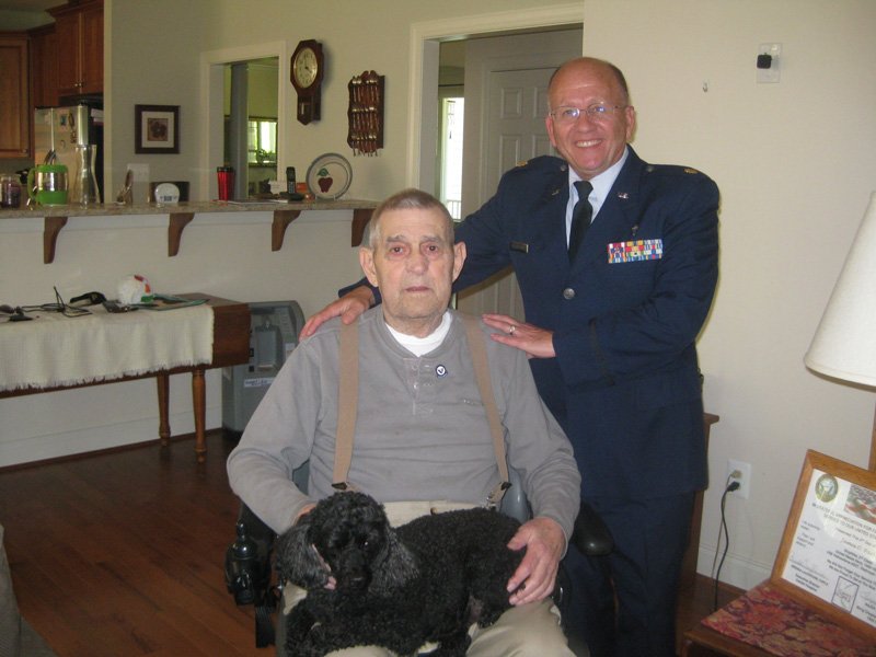Officer Standing Next to Man in Wheelchair